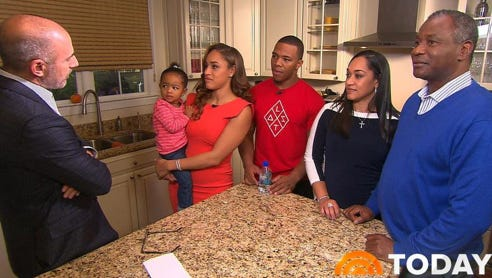"""Janay Rice, holding daughter Rayven, and Ray Rice are seen during an interview with """"Today"""" show host Matt Lauer in this image from video provided by The Today Show. Joining them are Janay's parents, Candy and Joe Palmer, right. Janay Rice says NFL Commissioner Roger Goodell wasn't being honest when he said Ray Rice was """"ambiguous"""" about hitting her in a casino elevator."""