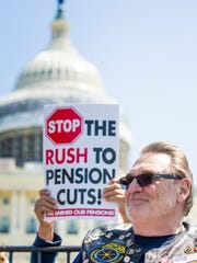 Tom Krekeler, of the Teamsters Local 100 in Cincinnati, listens to Rita Lewis speak to a large crowd rallying against the impending cuts of the Central States pension fund Thursday, April 14, 2016 at Capitol Hill in Washington, D.C.