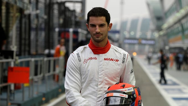 Alexander Rossi of the US poses for a portrait photo ahead of the first practice session at the Singapore Formula One Grand Prix on the Marina Bay City Circuit in Singapore, Sept. 18, 2015.