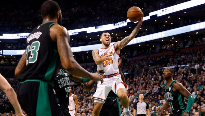 Phoenix Suns guard Mike James (55) goes to the basket during the second half against the Boston Celtics at TD Garden.