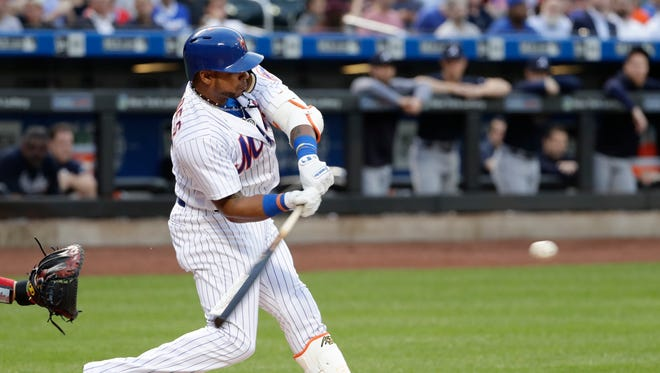New York Mets' Yoenis Cespedes hits a double during the first inning of the team's baseball game against the Atlanta Braves on Wednesday, May 2, 2018, in New York.