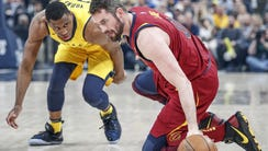 Cleveland Cavaliers center Kevin Love (0) steals a