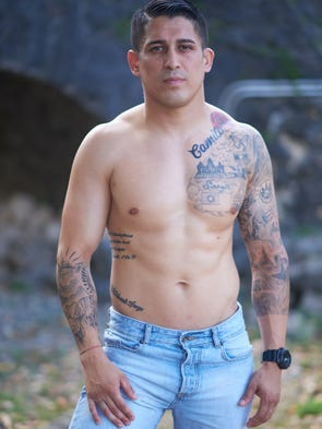 Jonahan Romero shows off his body art for the Pika