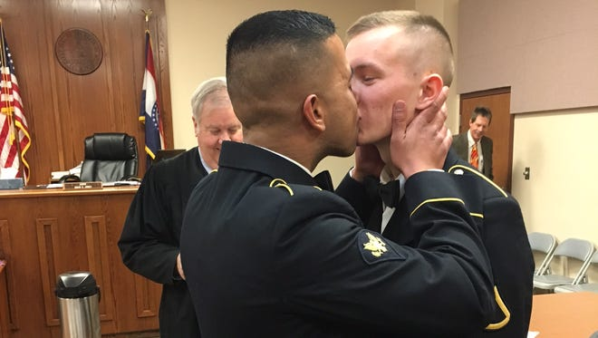 Spc. Shane Adriano (left) and Pfc. Tristian 'Cody' Resz were married at the Greene County Courthouse Feb. 11. This photo has since gone viral.