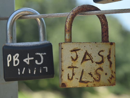 Most locks on the Byram Swinging Bridge symbolize couples' love for each other - but at least one lock might reflect a love for peanut butter and jelly sandwiches.