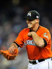 Miami Marlins starting pitcher Jose Fernandez (16) receives a baseball during the first inning against the Atlanta Braves at Marlins Park.\