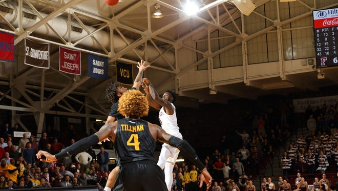Bishop Kearney graduate Antwoine Anderson made this 17-foot jumper over Virginia Commonwealth's Jonanthan Williams as time expired in overtime time on Wednesday night to give Fordham a thrilling 69-67 win.