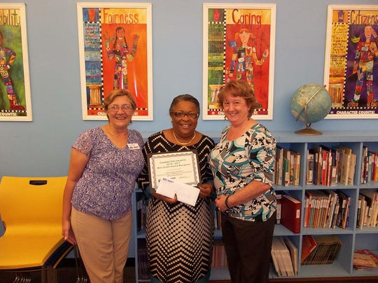 Character Counts! mini-grant winner Sheila Carpenter-Perry, of the Boys & Girls Clubs of Martin County, Port Salerno Club, with Cara Gabrielson,Character Counts!  Advisory Board member and Holly Laiben, director of Character Counts! in Martin County.