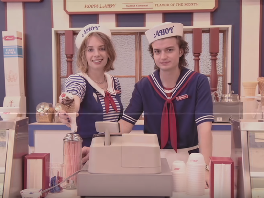 """In a new teaser for """"Stranger Things"""" season three, Steve Harrington, played by Joe Keery, works alongside Robin, played by Maya Hawke, at the ice cream shop Scoops Ahoy."""