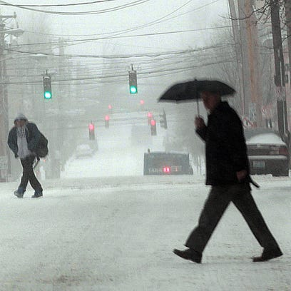 SNOW 4 0216  Pedestrians have Scott Street to themselves