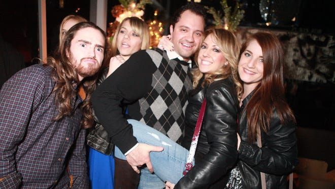 These friends are in the holiday spirit at Mazelpalooza at the Mint on Dec. 24, 2012, in Scottsdale.