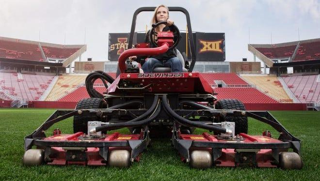 Iowa State University student Georgeanna Heitshusen sits on a Toro turfgrass machine inside Jack Trice Stadium in Ames.