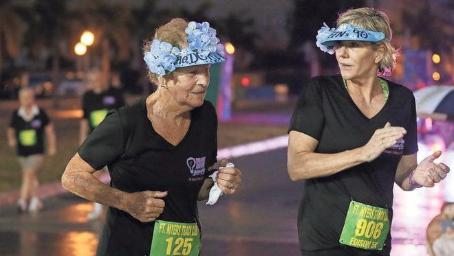 Doreen Johnstone, 90,  finishes the Edison Festival of Light 5K race in downtown Fort Myers Feb. 18. Johnstone completed her 10th Edison race since age 80.