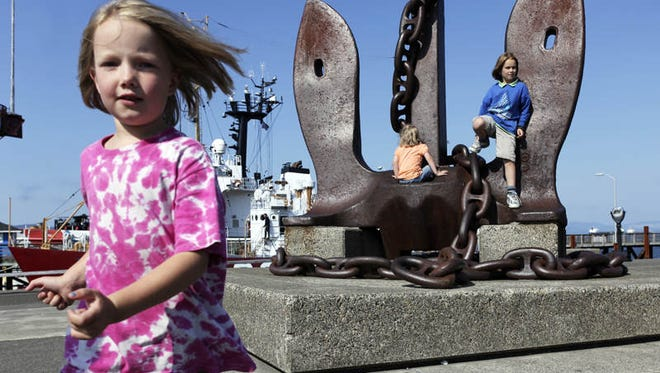 Jasmine Harrison, left, plays with her sisters Robin and Cheyenne at the Columbia River Maritime Museum. As Astoria celebrates its 200th birthday this year, the city has shed much of its hardscrabble past and looks forward to a newly tourist-driven future.