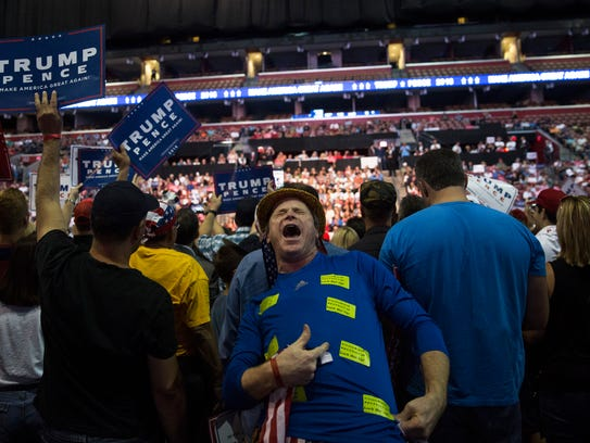 "A Trump supporter passionately shouts ""Lock Her Up,"""