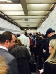 Commuters wait to get to the D train Tuesday night