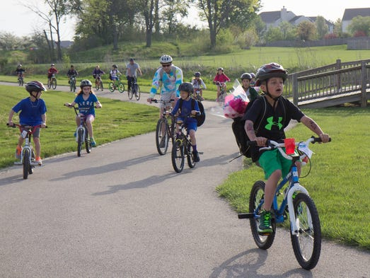 Oak Trace Elementary School Second Grade student Brandt Grabowski rides his bicycle through the Countryside neighborhood, Westfield, for Bike to School Day, May 7, 2014.