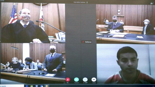 Video images are projected at the Friday arraignment of Steven Carrillo, seen at bottom right, for the June 6 killing of Santa Cruz Sheriff's Deputy Sgt. Damon Gutzwiller in front of Santa Cruz Superior Court Judge Paul Burdick, seen at top left. Carrillo appeared by video from Monterey County Jail, where he is being held without bail in Santa Cruz.