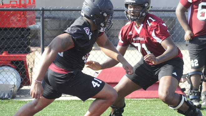 Gadsden City's Rod Orr blocks Terrence Peeples on Aug. 6 during fall practice at Titan Stadium.
