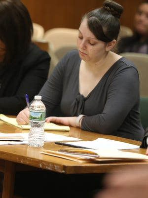 Erica Bell looks down, as she did during most of the prosecution's opening statement.