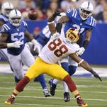 Indianapolis Colts cornerback Vontae Davis (21) knocks the ball out of the hands of Washington Redskins wide receiver Pierre Garcon (88) in the first half against the Washington Redskins at Lucas Oil Stadium on Nov. 30, 2014.