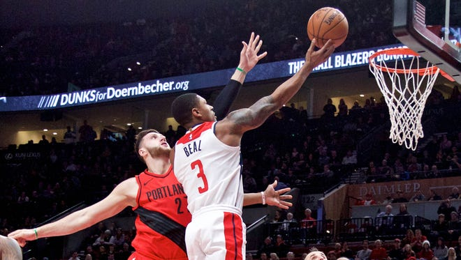 Bradley Beal shoots over the Portland Trail Blazers' Jusuf Nurkic during the first quarter at the Moda Center.