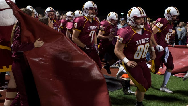 Gibson Southern Titans enter the field at Gibson Southern High School in Fort Branch, Ind., on Friday, Nov. 3, 2017.