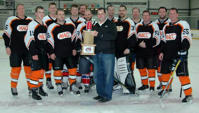 Tom McCord presents a trophy to the winning team in the first Light the Lamp charity hockey tournament at Carmel Ice Skadium in May 2013. The tournament has been played ever year since to provide fundraising support to the campaign of a member of the hockey community who competes in the Leukemia & Lymphoma Society's annual Man or Woman of the Year event. The competition gives entrants 10 weeks to raise as much money as possible to fund blood cancer research.