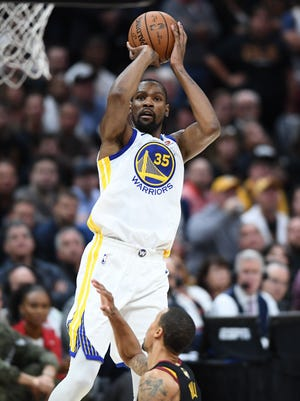 Golden State Warriors forward Kevin Durant shoots against the Cleveland Cavaliers during the second quarter of Game 3 of the 2018 NBA Finals.