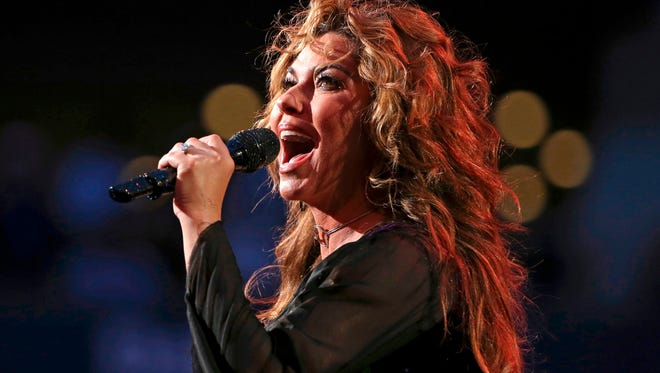 In this 2017, file photo, Shania Twain performs during opening ceremonies for the U.S. Open tennis tournament in New York. Twain has apologized for saying if she were American she would have voted for Donald Trump for president, even though he's offensive.