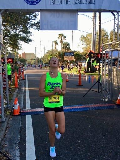Jen Absher wins the women's Eye of the Dragon 10K race