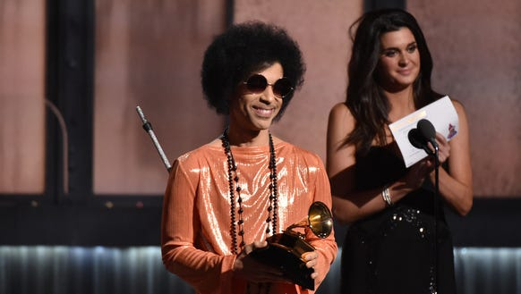 Prince got an entire essay in the book about him, seen