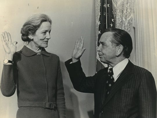 Margaret Chase Smith, who served as a Republican in both the U.S. Senate and House of Representatives, is shown being sworn in by Speaker of the House Carl Albert in this undated file photo.
