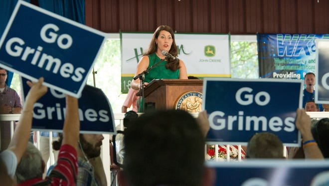 Alison Grimes is cheered by supporters while speaking at Fancy Farm.