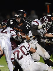 New Paltz's Brian Kenney makes a tackle against Marlboro's