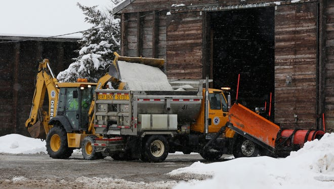 An end loader loads salt into a City of Oshkosh salt and plow truck after the Oshkosh area received six inches of snow overnight.   City crews were busy plowing the roads and putting down salt January 26, 2016.