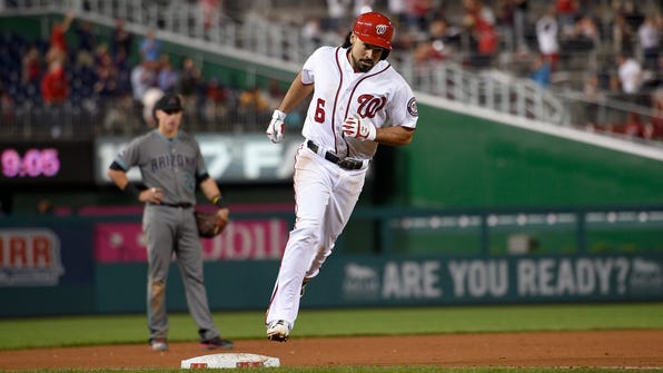Washington Nationals' Anthony Rendon (6) rounds third as he heads home after he hit a three-run home run during the sixth inning of a baseball game against the Arizona Diamondbacks, Tuesday, Sept. 27, 2016, in Washington. (AP Photo/Nick Wass)