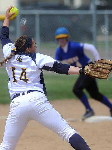 Augustana's #14 Carley Pickett pitches against Southeastern Oklahoma State during softball at Bowden Field in Sioux Falls, S.D. Saturday, May 17, 2014.