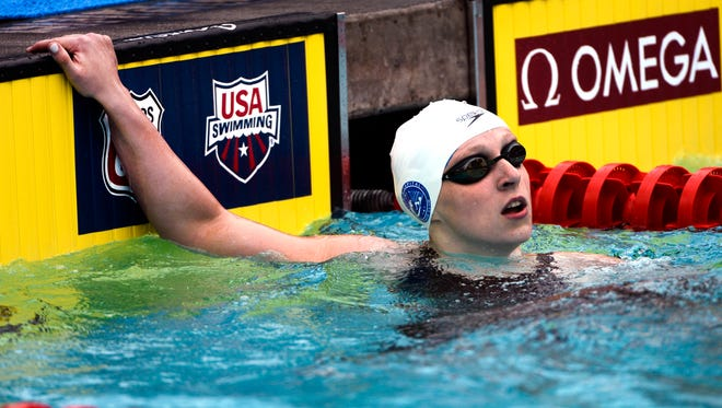 Katie Ledecky looks at her time at the conclusion of the women 200 during the USA Swimming Nationals at William Woollett Jr. Aquatics Complex.