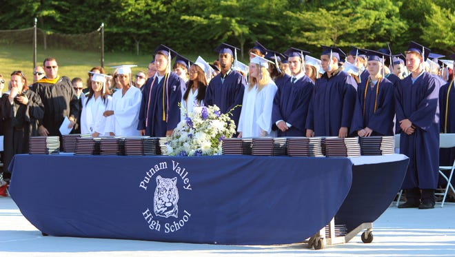 Graduates of Putnam Valley High School celebrate their commencement in Putnam Valley on June 27, 2014.