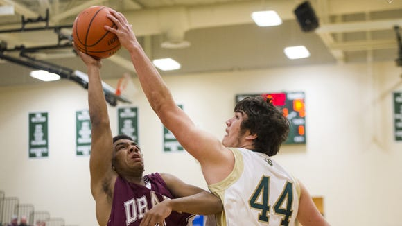 Wilson Memorial's Justin Leary blocks a shot from Stuarts