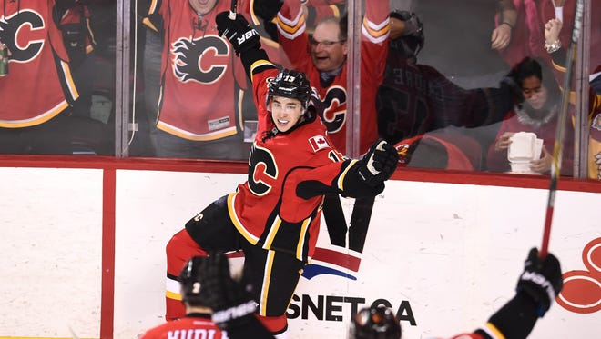 Calgary Flames left wing Johnny Gaudreau (13) celebrates his second-period goal on the Vancouver Canucks in Game 6 of the first round of the 2015 Stanley Cup playoffs at Scotiabank Saddledome.
