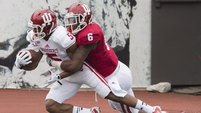 Indiana linebacker Zeke Walker (6) tackles wide receiver J-Shun Harris II (5) in the red zone during the Cream and Crimson Spring Game on Saturday, April 18, 2015, at Memorial Stadium in Bloomington. (James Brosher / For The Star)