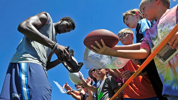 Titans player Justin Hunter signs autographs for fans during the Titans first training camp at Saint Thomas Sports Park.
