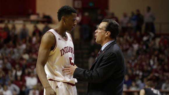 Tom Crean talks with Troy Williams during the 2014 season.
