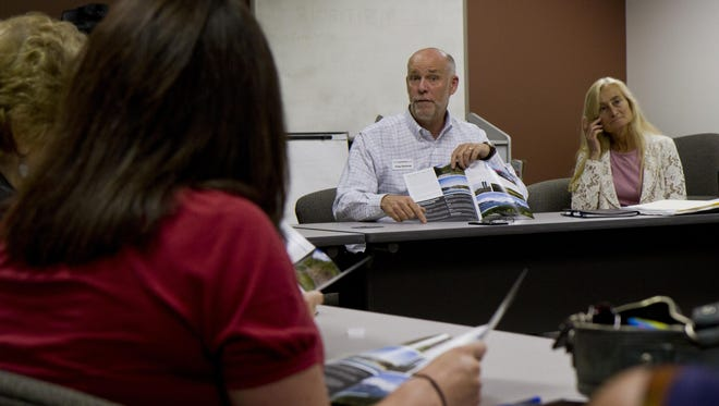 Greg and Susan Gianforte speak with Great Falls community leaders in June as he made a statewide tour pitching telecommuting.