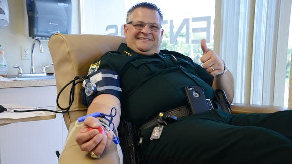 """Brevard County Sheriff Wayne Ivey was one of dozens of people who waited in line at OneBlood in Titusville to donate blood in honor of BCSO Agent John """"Casey"""" Smith, who was shot Thursday."""