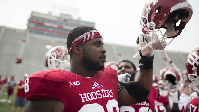 Indiana defensive lineman Darius Latham (98) sings the alma mater after the Cream and Crimson Spring Game on Saturday, April 18, 2015, at Memorial Stadium in Bloomington. (James Brosher / For The Star)