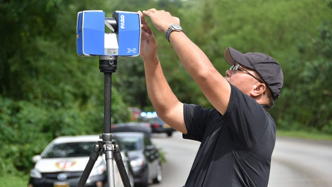 Guam Police Department Highway Patrol Division officers learned to use a FARO forensic mapping scanner in Yona on Oct. 7, at a recent accident scene. Business representatives are scheduled to demonstrate the mapping system to local law enforcement personnel on Oct. 8.