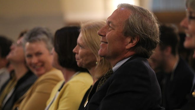 University of Iowa President Bruce Harreld listens to John Pappajohn at the Iowa Memorial Union on Friday, Oct. 9, 2015.